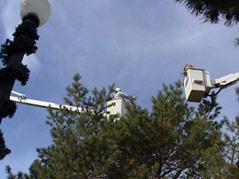 sioux falls workers hang light at falls park winter wonderland preparations
