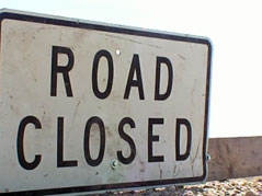 road closed flooding lake county sign gravel damage