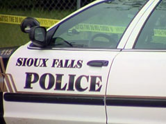 sioux falls police car officer crime scene tape investigation