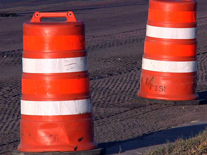orange cones road construction zone detour
