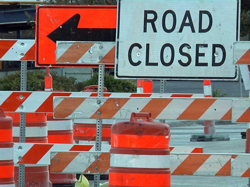 orange cones road construction zone detour road closed