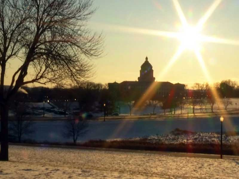 pierre capitol building legislature lawmakers winter snow sun beautiful