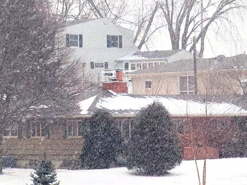 wintertime, light snow falling outside