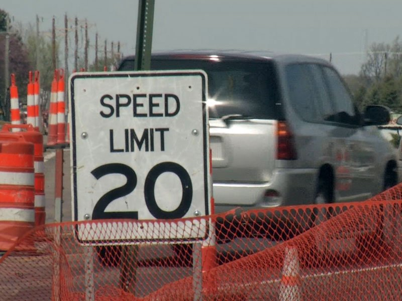 Speed limit sign in construction zone