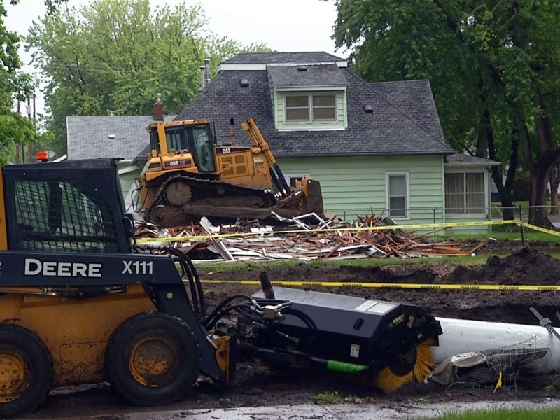 tearing down homes for Sanford