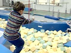 Shot of kid on gymnastics equipment