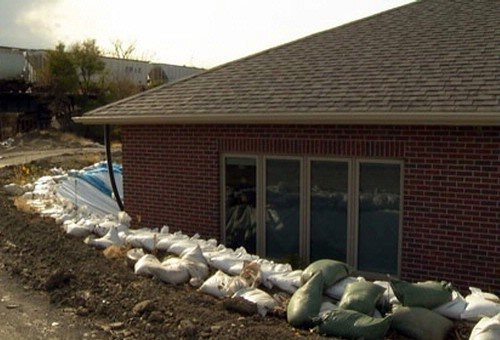 Sandbags surrounding home in Marion