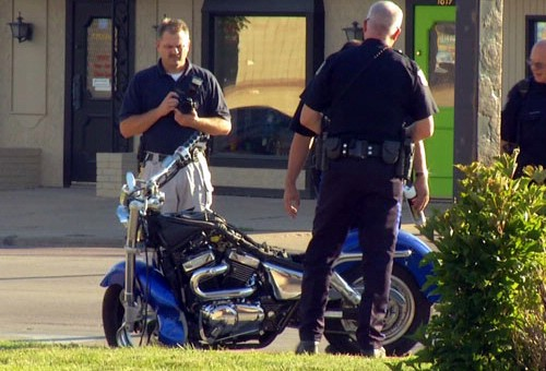 Police examine the motorcycle