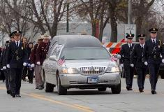 Casket is escorted to Washington Pavilion