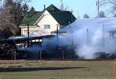 Shell of school bus and smoke