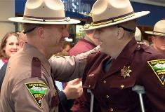 Trooper Shannon Orth pats Steen on the back