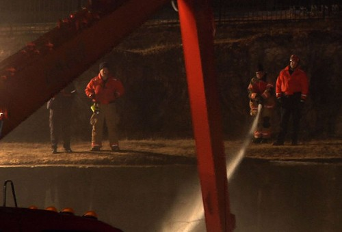 Crews spraying down foam to try to clear it