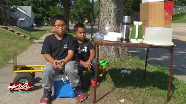 Young Entrepreneurs Cash In With Coffee Stand