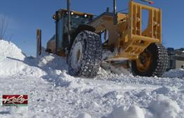 Wind, Snow Drifts Challenge Plow Drivers